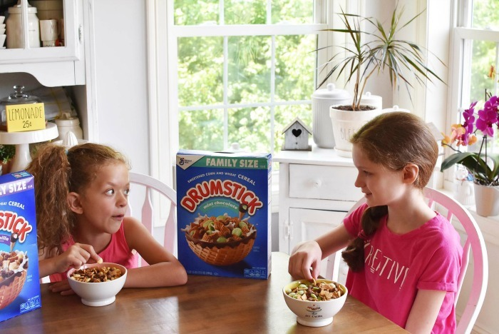 kids eating Drumstick cereal at kitchen table