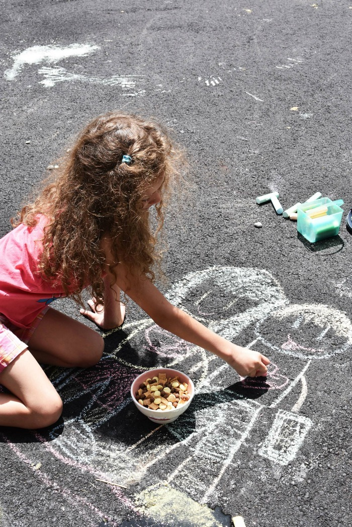 kids playing outside with chalk