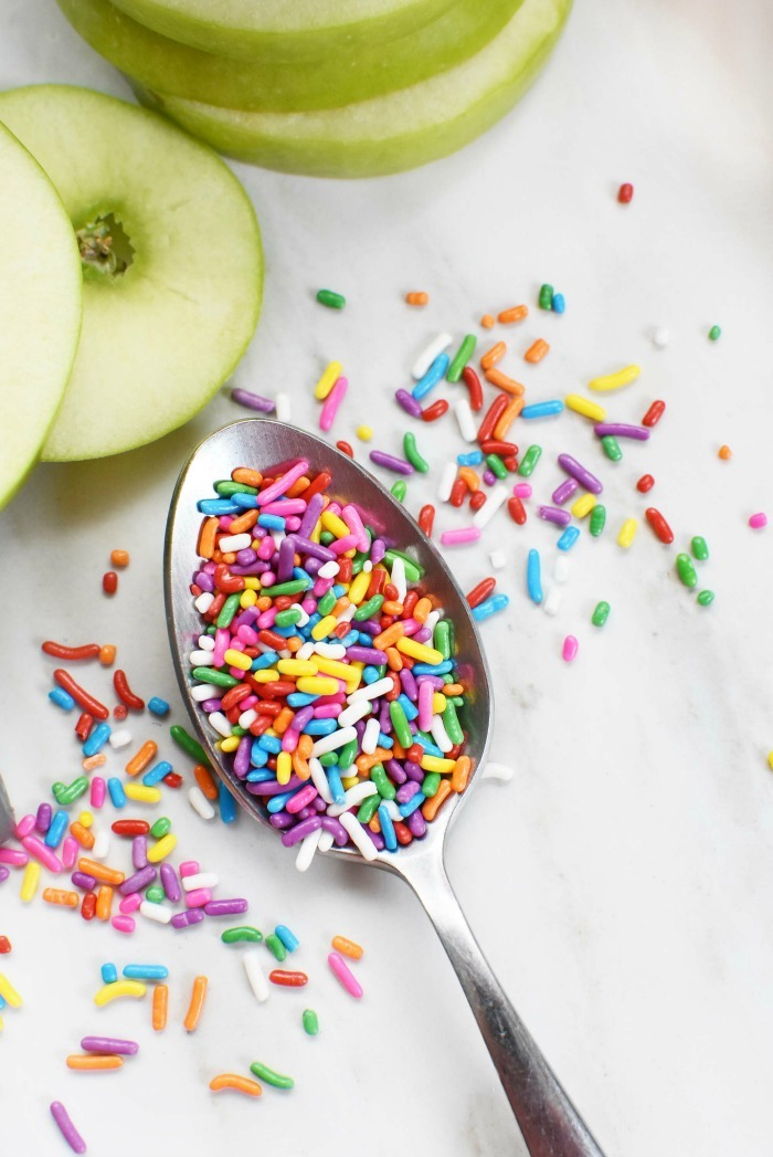 Spoon of rainbow sprinkles