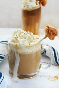 Hot apple latte with caramel apple stirrer