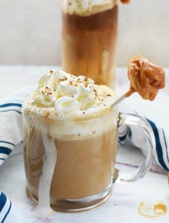 Hot apple latte with caramel apple stirrer