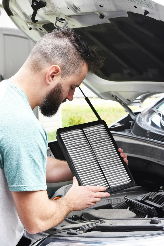 Man Checking Cabin Air Filter