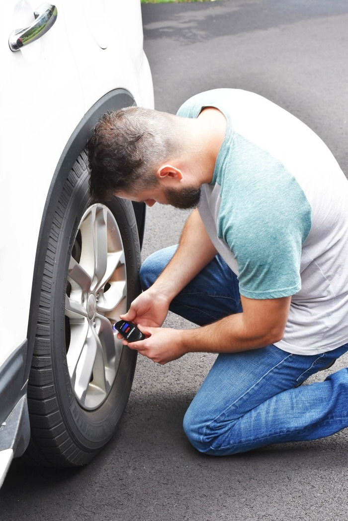 Man Checking Tire Pressure