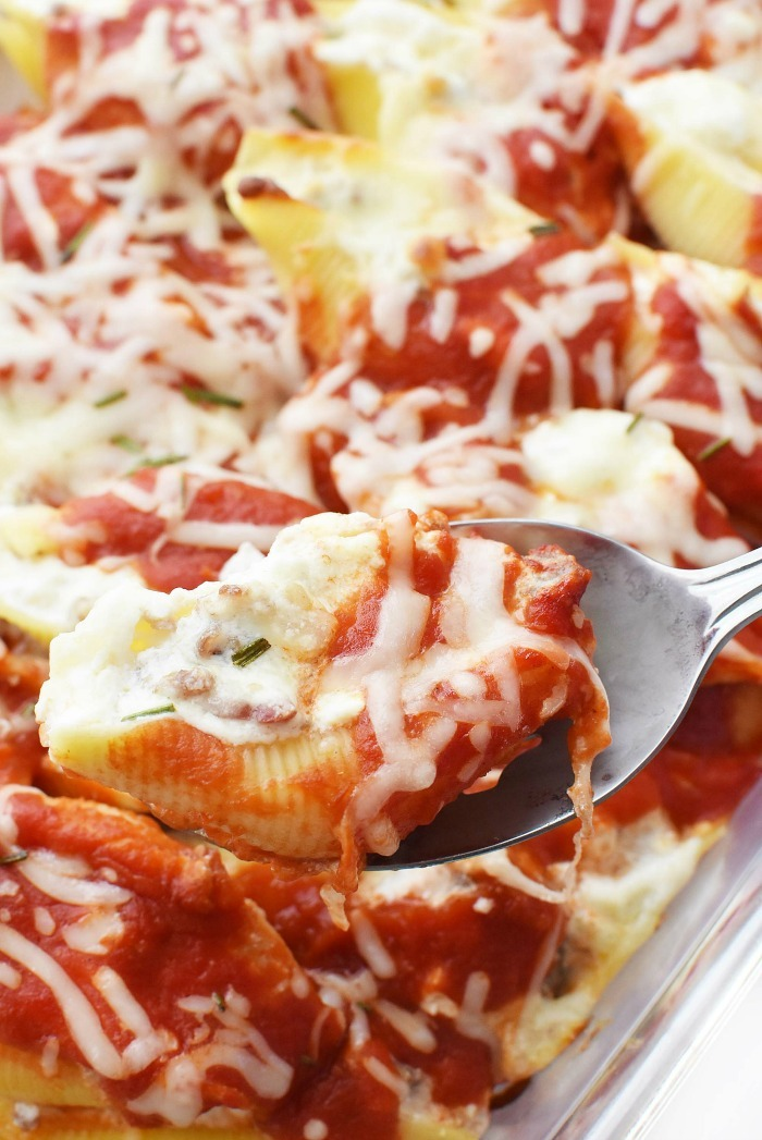 Bacon Sausage Stuffed Shells in spoon.