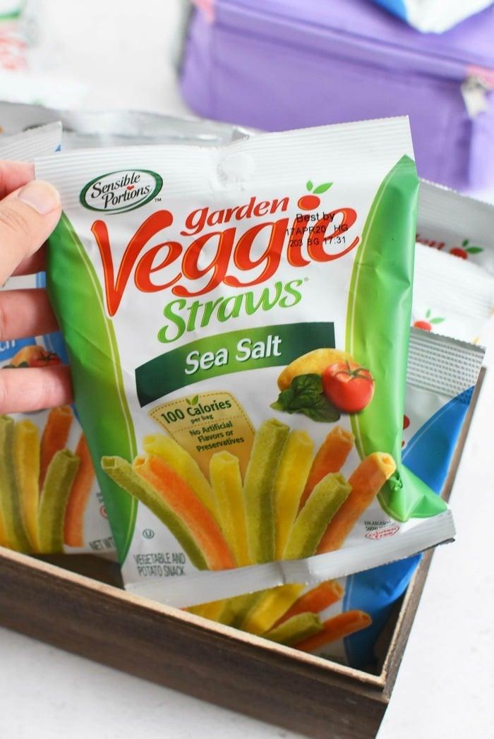 Garden Veggie Straws in hand.