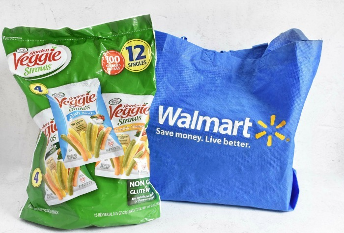Garden veggie straws multipacks on a white table with a Walmart reusable bag.