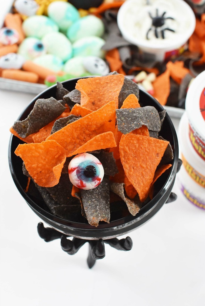 Halloween Snack Tray Chips in black bowl candy eyeball.