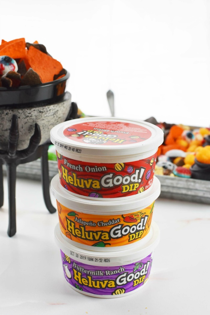 Heluva Good Dip containers on Halloween themed table.