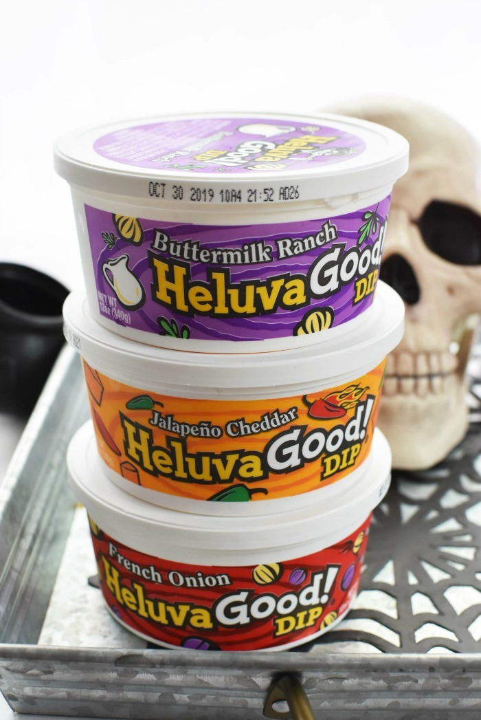 Heluva Good Dips stacked on Halloween table.