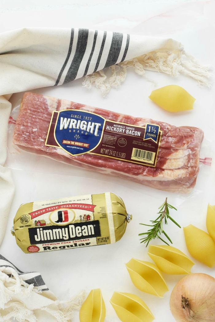 Jimmy Dean Sausage and Wright Bacon  on white table with a striped napkin.