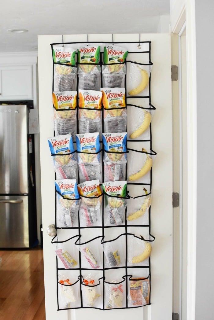 Over the door snack holder with Veggie Straws snacks inside.