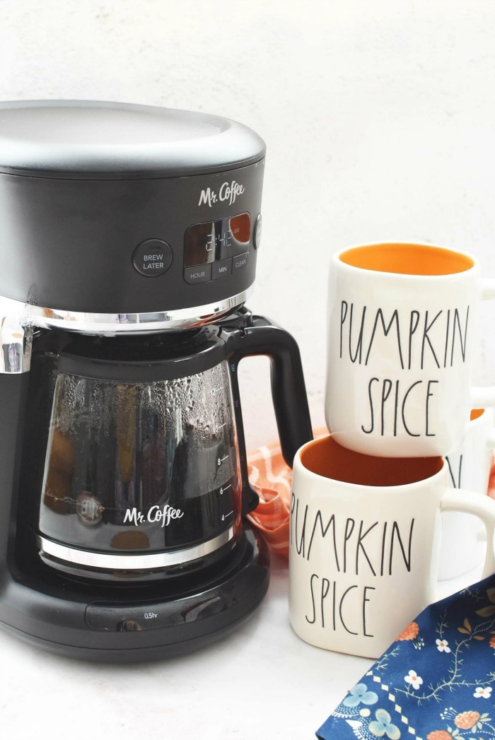 Pumpkin spice mugs with coffee