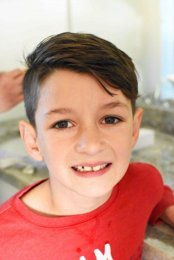 Boy with clean teeth