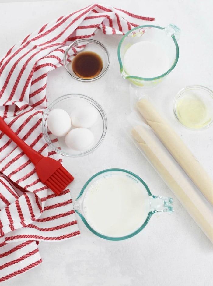 Custard Tart Ingredients on a white table.