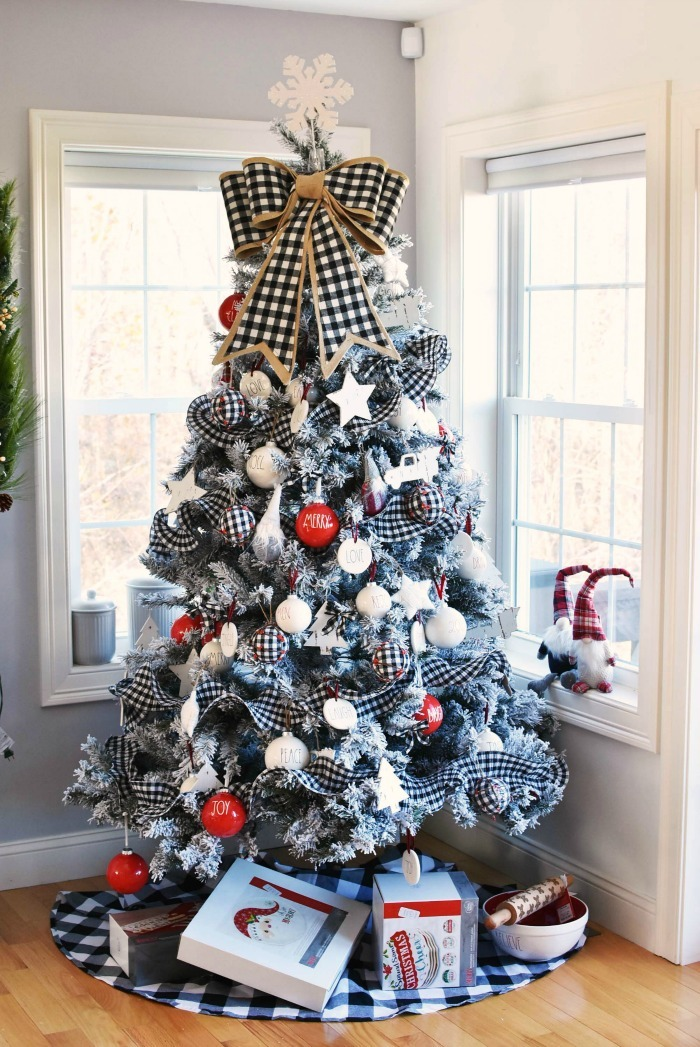 Farmhouse Rae Dunn inspired red and buffalo plaid tree with gifts underneath.