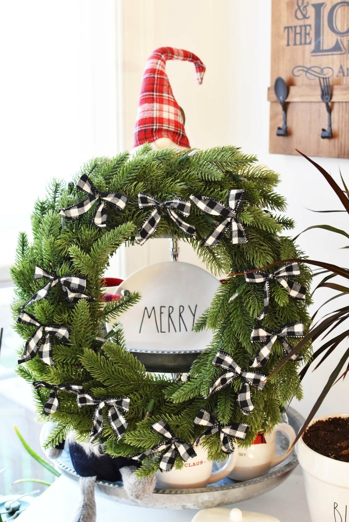 Farmhouse buffalo plaid wreath on tiered tray.