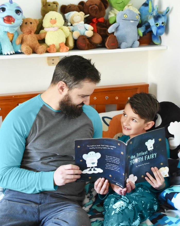 Father Reading to Son in his bedroom.