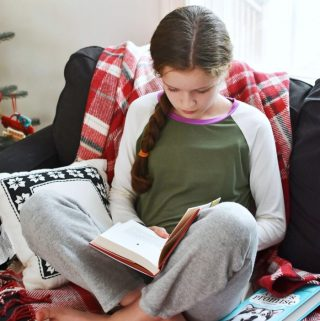 Girl reading Lily's Story