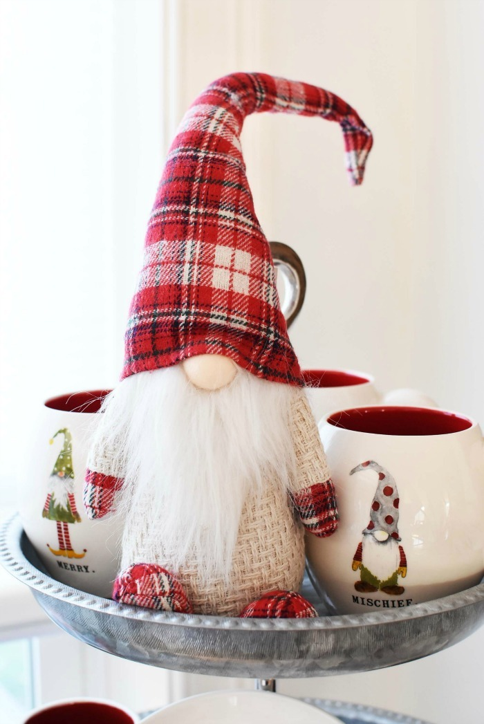 Plaid, red gnome on tiered stand.