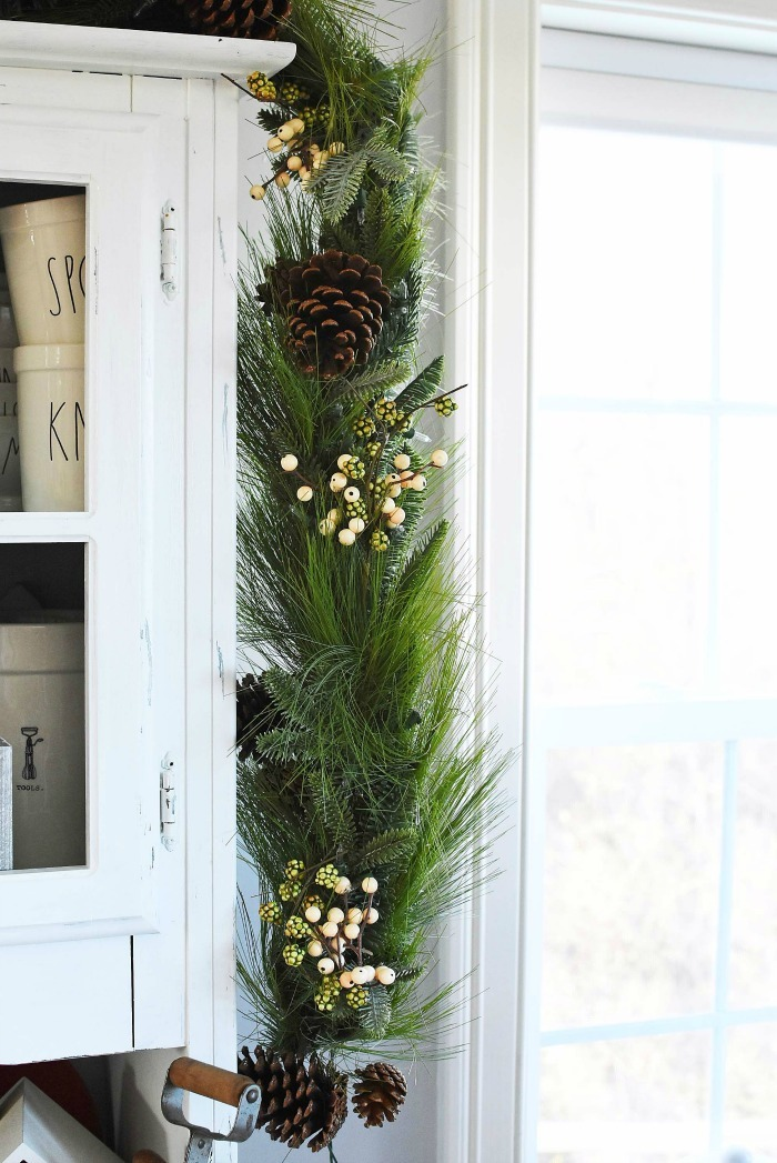 Harvest Pine Garland on white hutch.
