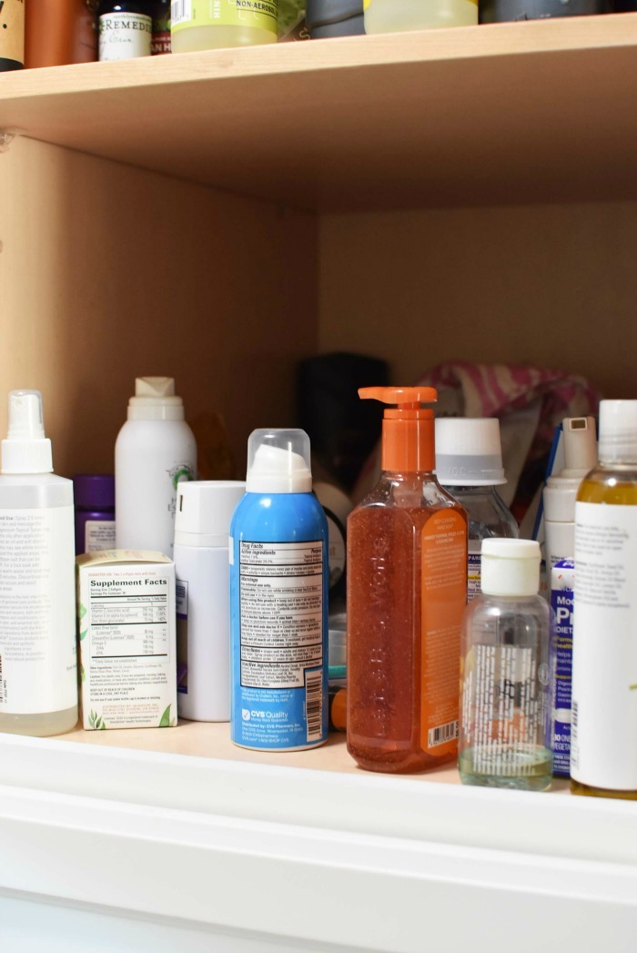 Inside look of medicine cabinet with assorted meds and hand soap.