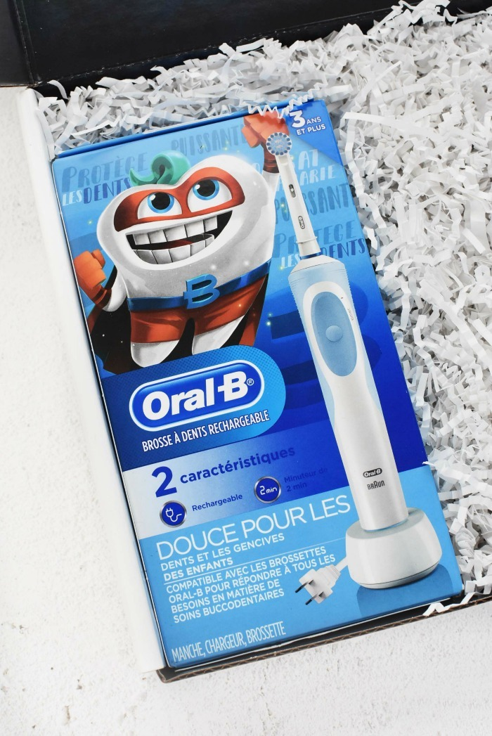 Oral B Kids Electric toothbrush on white table.
