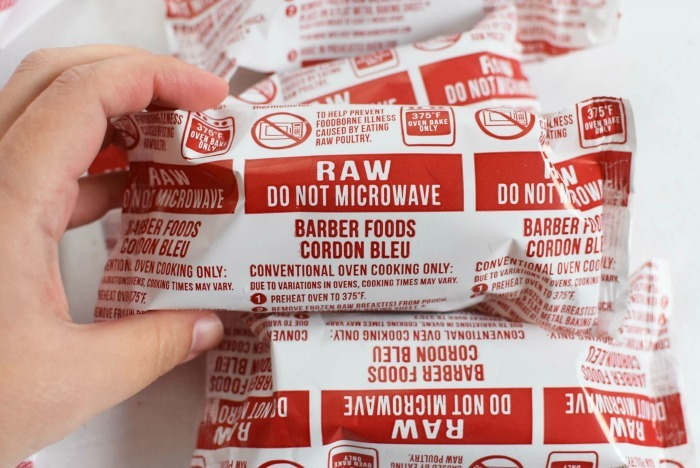 Raw Barber Foods Cordon Bleu packs in hand.