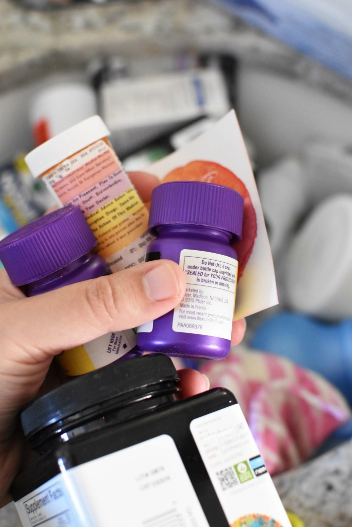 Recyclable medicine bottles in hand.