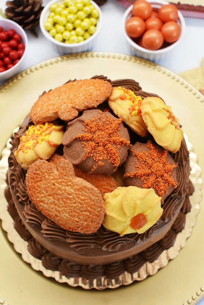 Thanksgiving Bettercreme Cake with cookies on top.