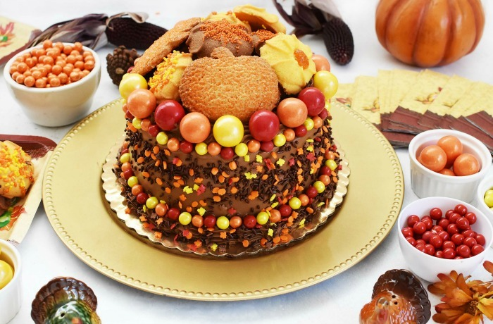 Thanksgiving Chocolate Cake on a gold platter with Harvest themed table spread.