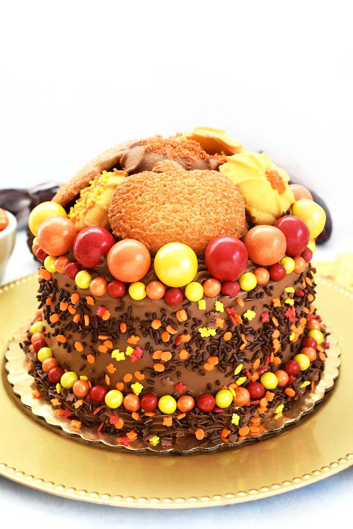 Thanksgiving Cookie Topped Cake on a gold platter.