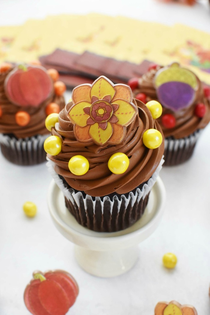 Chocolate Thanksgiving Flower Cupcake on little white stand.
