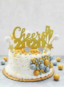 2020 New Year Cake with gold and silver gumballs and star picks.