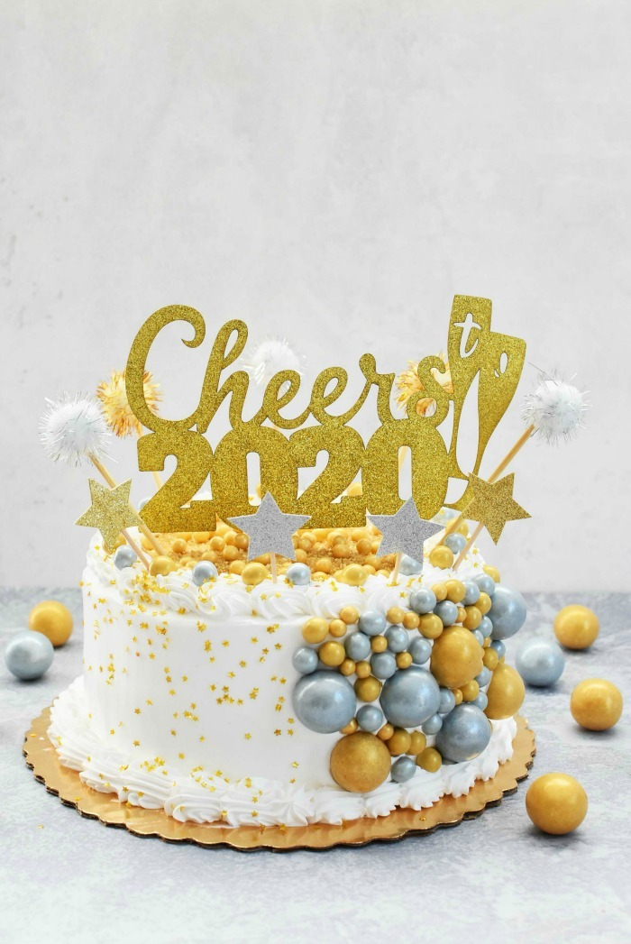 2020 New Year Cake with gold and silver candies.