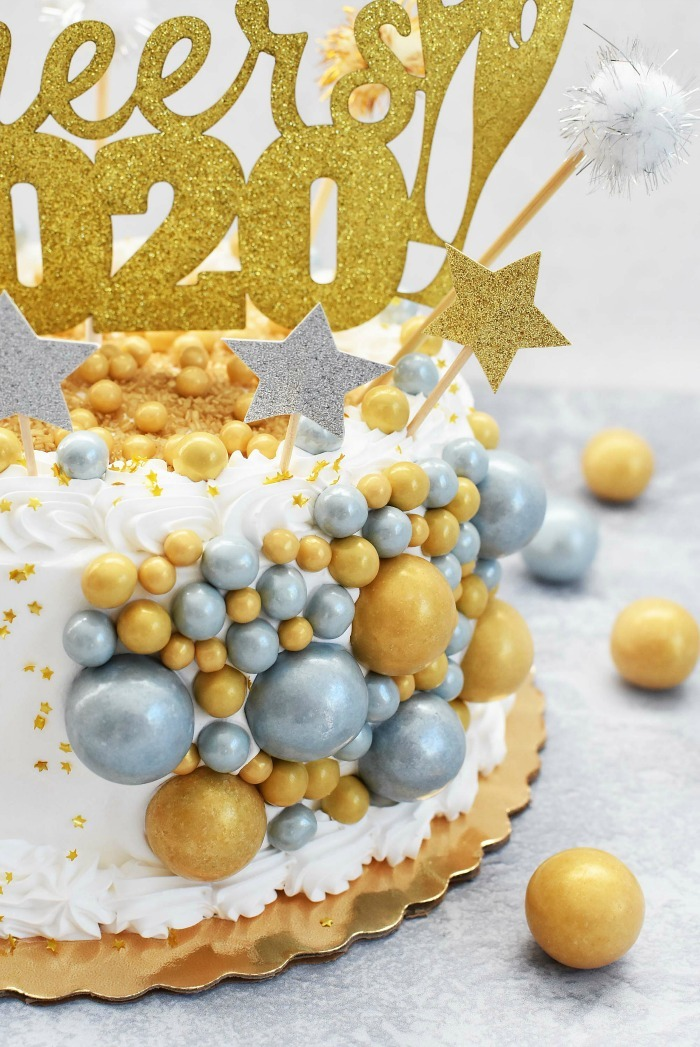 Side, up close view of the gold and silver candies on the Candy New Year Cake.