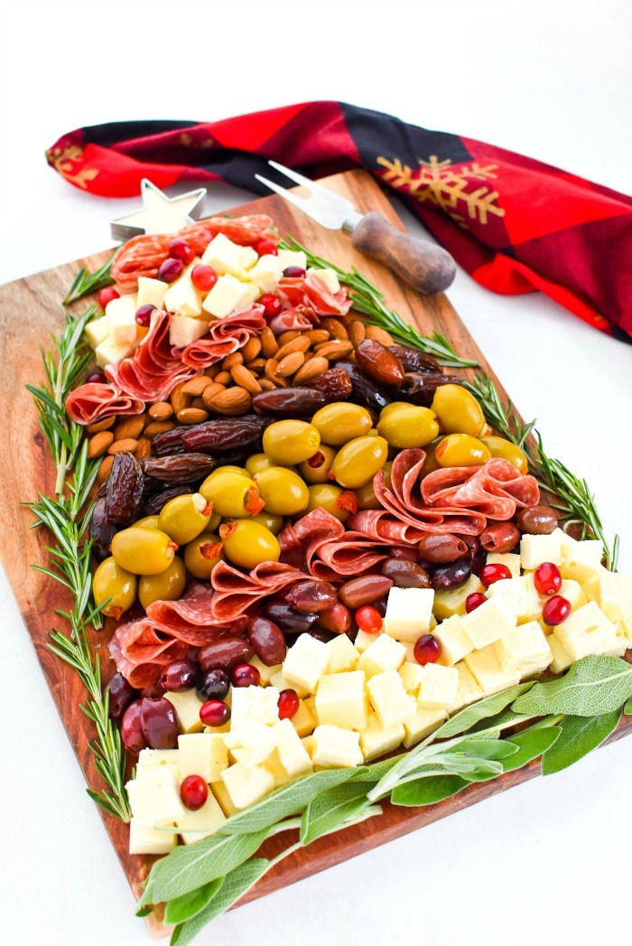 Cheese and Meat Christmas Tree Board on white table.