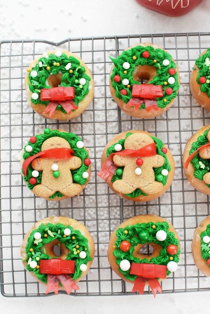 Christmas Wreath donuts on baking rack.