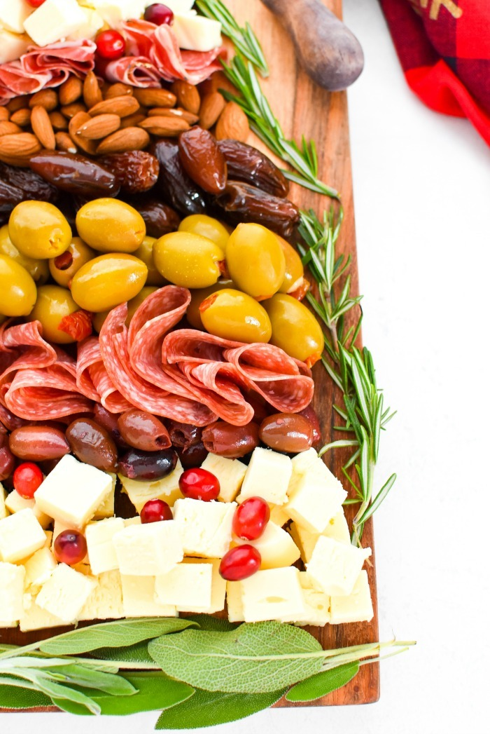 Christmas Snack Board up close view of meat, cheese, and olives.
