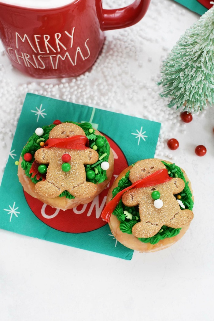 Gingerbread Cookie men on wreath donuts with Christmas napkins.
