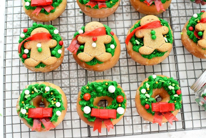 Holiday donuts on a baking rack.