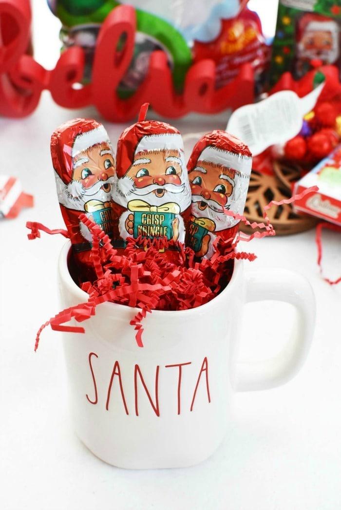 Santa chocolates in white Santa Rae Dunn mug.