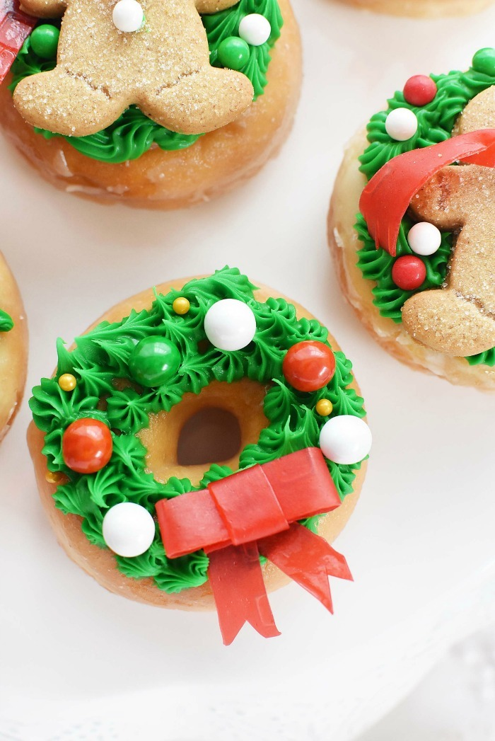 wreath donuts up close on a white table.