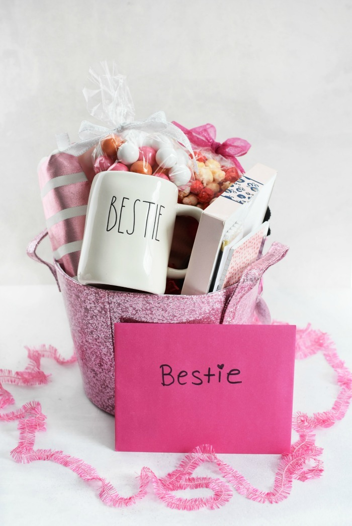 Pink bestie Gift Basket on a white table.