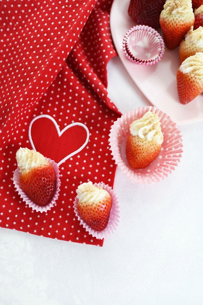 Cheesecake Stuffed Strawberries with red heart napkin.