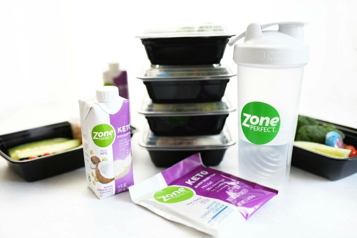 Low Carb meal planning supplies on white table.