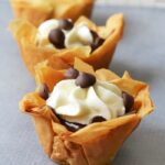 Mini Chocolate Cream Filo Dough Pies on a grey background