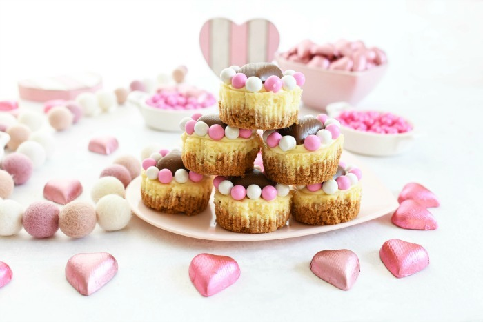 Mini Valentines Day Cheesecake Recipe stacked on heart plate.