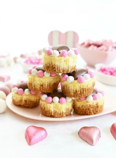 Mini Valentine's Cheesecakes stacked on a heart-shaped plate.