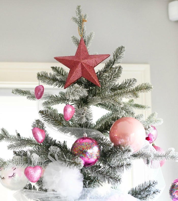 Pink star on tree with pink balls.