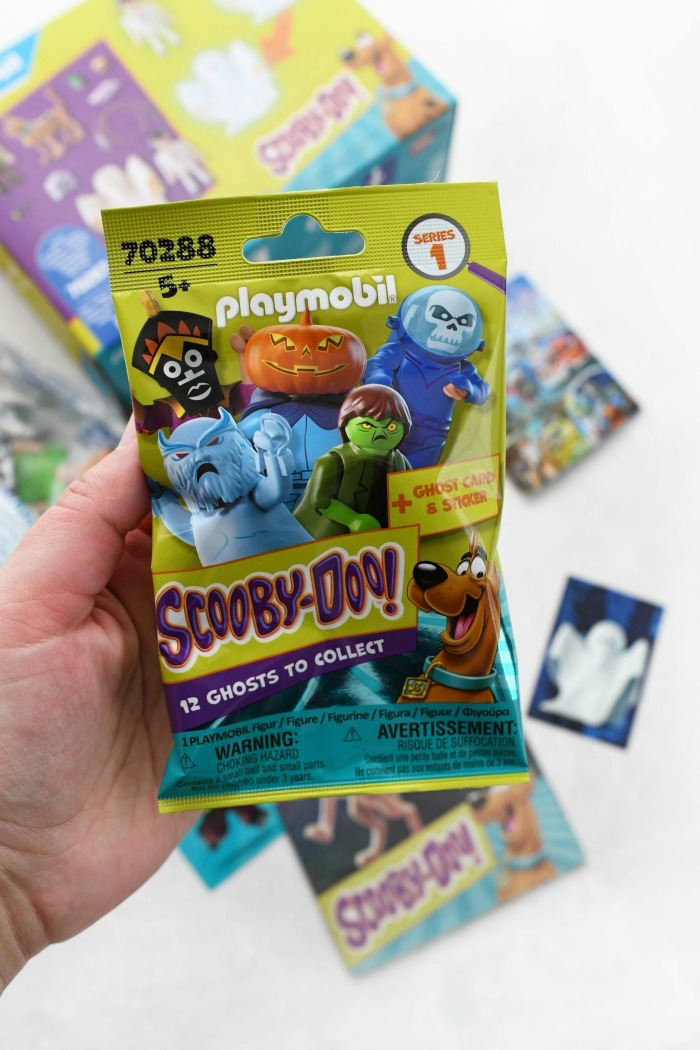 Playmobil Scooby Doo packs in hand.